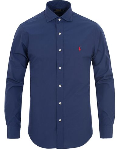 Polo Ralph Lauren Slim Fit Estate Cut Away Poplin Shirt Reactive Blue i gruppen Kläder / Skjortor / Casual skjortor hos Care of Carl (13197211r)
