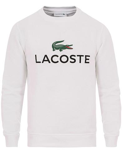 Lacoste Logo Crew Neck Sweatshirt White i gruppen Kläder / Tröjor / Sweatshirts hos Care of Carl (14549011r)