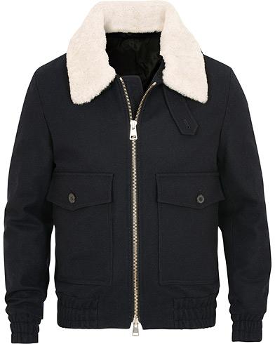 AMI Blouson Shearling Poches Plaquees Jacket Navy i gruppen Tøj / Jakker / Dunjakker hos Care of Carl (15089011r)