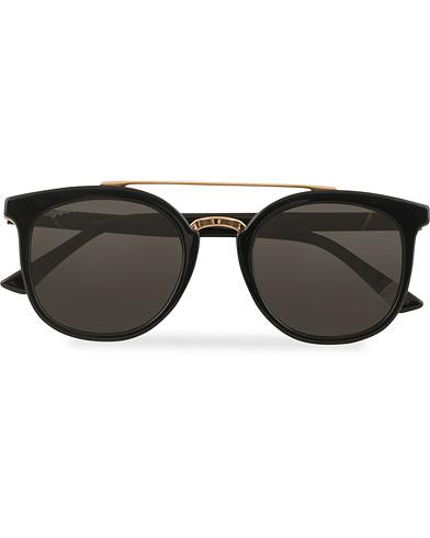 GUCCI GG0403S Sunglasses Black/Grey  i gruppen Assesoarer / Solbriller / Buede solbriller hos Care of Carl (15400510)